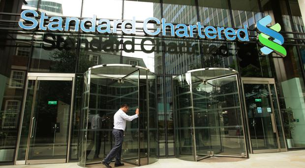 Asia-focused Standard Chartered shrugged off weak commodity prices and volatile Chinese markets to move back into profit