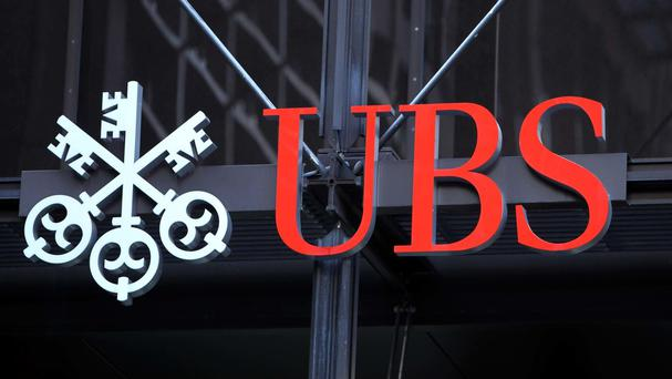 Pre-tax operating profit at UBS's wealth management arm fell 41% to 557 million Swiss francs (£398m)