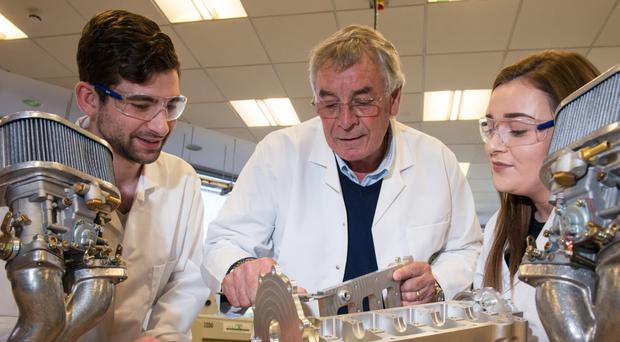 Gary Anderson and two students get hands-on in lab