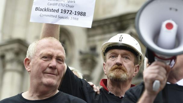 Protesters outside the Royal Courts of Justice before a court hearing relating to the settlement of blacklist litigation