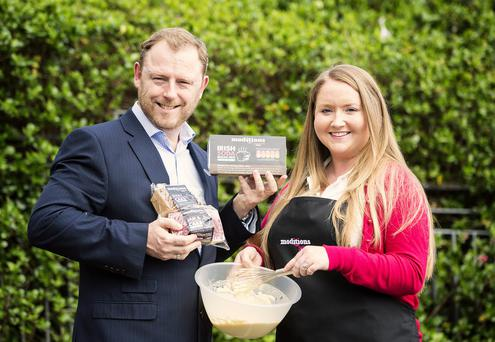 Sean Largey, Tesco NI's commercial manager, and Christine Shaw, founder of Moditions Bakery, announce the deal worth around £220,000
