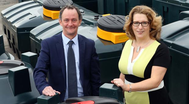 Nicola Coey, Director at Harlequin is pictured with Matt Hickey, Corporate Field Account Manager, BT Business who designed the company's new bespoke leading edge telephone system