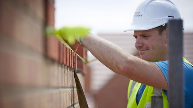 Housebuilder Taylor Wimpey has upgraded its profit guidance for the year