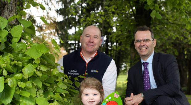 Mark O'Brien, commercial branch manager of Bank of Ireland UK, with Michael Logan (left) of Belfast Fairy Doors and his daughter Jessica
