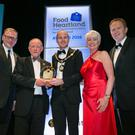 From left: Roger Wilson, chief executive of Armagh City, Banbridge and Craigavon Borough Council; Brian Irwin from Irwin's Bakery who won the Industry Ambassador Award; Lord Mayor of Armagh City, Banbridge and Craigavon Borough Council, Darryn Causby; host for the awards Pamela Ballantine and councillor Paul Greenfield, vice chairman of the council's Economic Development and Regeneration Committee