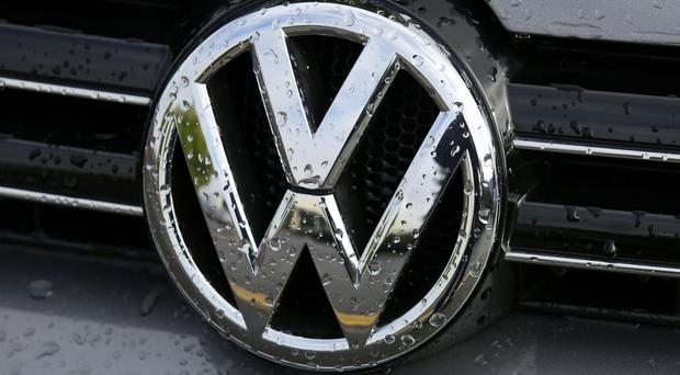 Profits at Volkswagen tumbled almost a fifth at the start of the year as the car-maker continued to grapple with the fallout from its global emissions scandal.