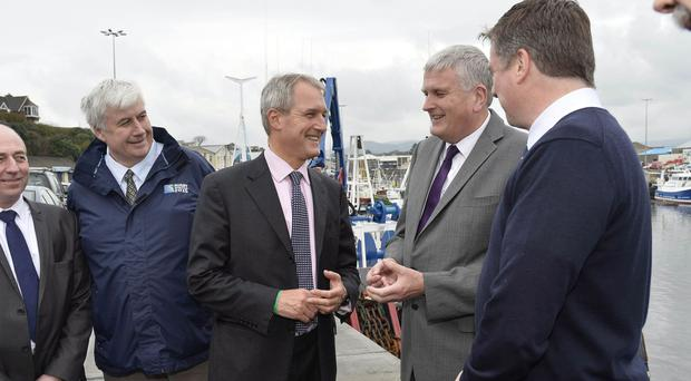 Owen Paterson, former Secretary of State for Northern Ireland, with DUP MLA Jim Wells during a visit to Kilkeel to speak with fishermen