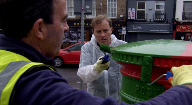 Ardal O'Hanlon paints postboxes in Dublin as part of the show