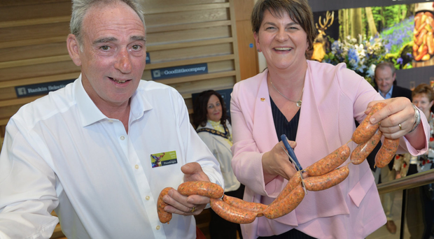 Finnebrogue's chairman Denis Lynn and First Minister Arlene Foster officially open the new Finnebrogue processing facility in Downpatrick by cutting a ribbon of sausages