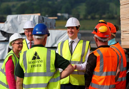 Chancellor George Osborne meets workers during a visit to Warrenpoint Harbour in Co Down yesterday