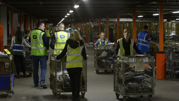 Staff in the warehouse during a tour of the Sports Direct headquarters in Shirebrook, Derbyshire