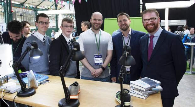 Liam Broadway and Sam Stuart students from Dominican College Portstewart with Mike Robinson and Roger Busby; Deloitte Digital and Simon Hamilton MLA, Finance Minster at The Digital DNA 2016 event in St George's Market