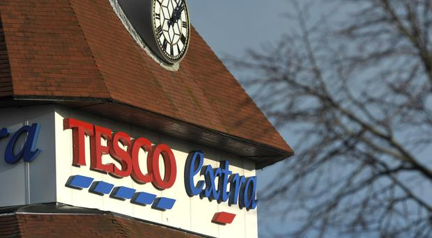 The FTSE 100 Index was 1.9% down at 6115.8 as investors took flight from Tesco