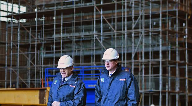 David Cameron (right) pictured during a visit to Govan shipyard