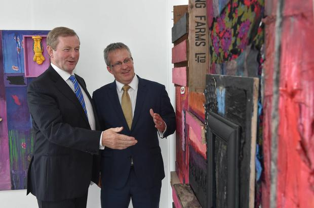 Taoiseach Enda Kenny at Ulster University's Belfast campus with vice chancellor professor Paddy Nixon