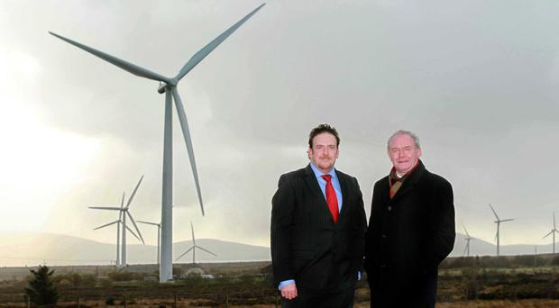 Paul Cooley from SSE Renewables and Deputy First Minister Martin McGuinness visiting Slieve Kirk wind park