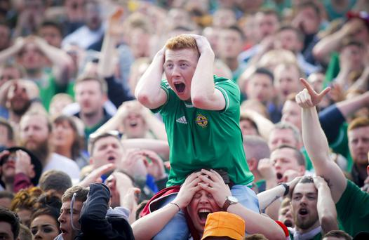 NI fans watch the match against Poland from the Titanic fanzone
