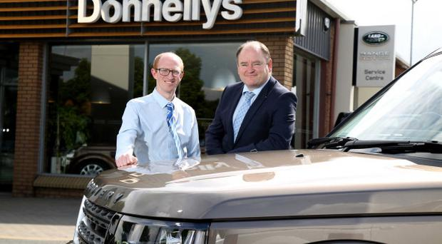 Gary Holmes, left, IT Support Engineer at Donnelly Group, with Graham Childs, ICT Sales Specialist at BT Business & Public Sector in Northern Ireland