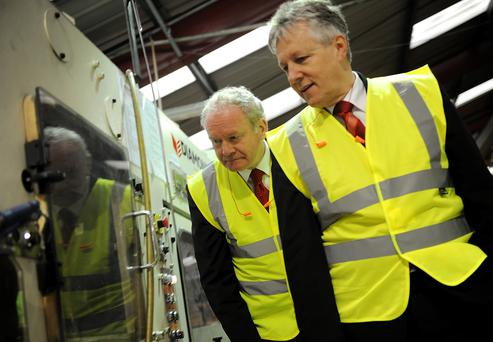 Former First Minister Peter Robinson and Deputy First Minister Martin McGuinness visiting Diamond Corrugated