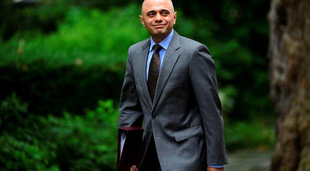 Business Secretary Sajid Javid arrives to attend a Cabinet meeting at 10 Downing Street yesterday