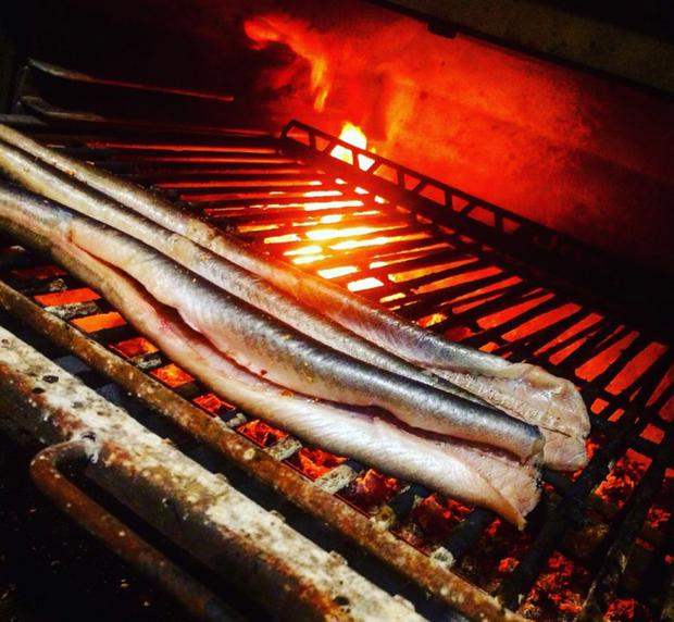 Lough Neagh eels cooking on a grill in Uluru in Armagh
