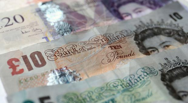 File photo dated 7/11/2014 of Fifty, Twenty, Ten, and Five pound notes. Investment scam victims are losing £20,000 on average to frauds which may involve fake diamonds, bogus stocks and shares and fine wines that do not really exist, Citizens Advice is warning.
