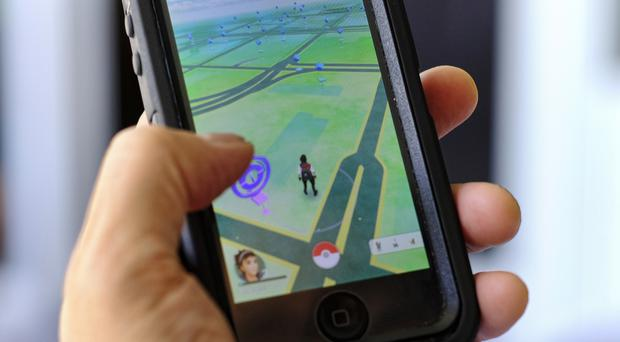Pokemon GO has become the top-grossing app in the US (AP)