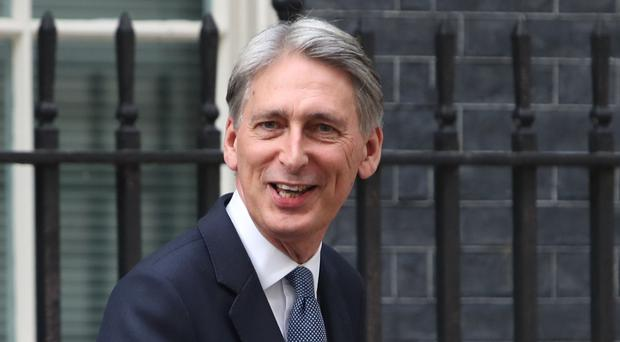 Philip Hammond leaves 10 Downing Street after being appointed Chancellor of the Exchequer