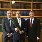 From left: Carson McDowell managing partner Michael Johnston with Timothy Cockram and the firm's partner Hugh McGrattan