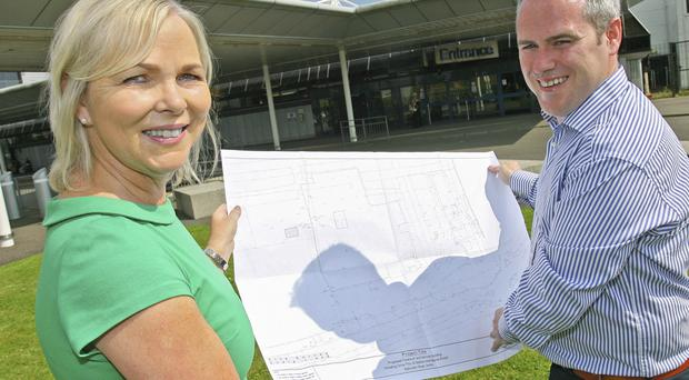 Belfast International Airport property manager Katrina Gilchrist and Canice Mallaghan from Moorefield Contracts look over plans for a new £2.5m retail and fuel forecourt adjacent to the airport