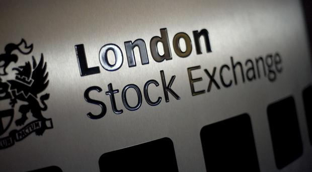 The FTSE 100 Index was down 20.66 points to 6,708.1