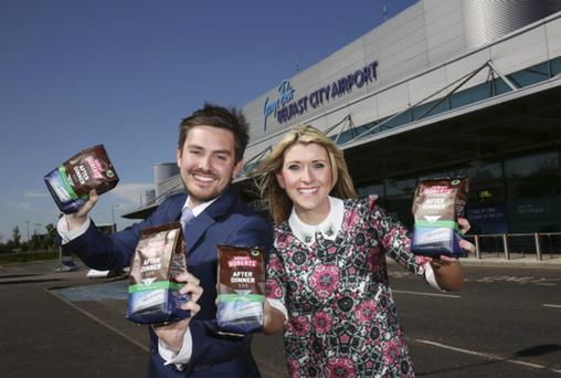 Craig Blaney of Robert Roberts celebrates its new coffee packaging, which features an image of George Belfast Belfast City Airport, with Cliona Arthur from the airport