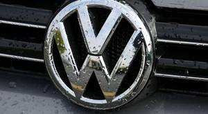 "A spokesman said Volkswagen had delivered ""solid results in difficult conditions"""