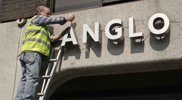 The most infamous commercial sign in Irish history, that of Anglo Irish Bank is taken down by Ken Glennan, from outside its former HQ at St Stephen's Green in Dublin