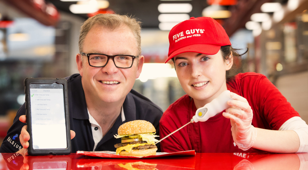 Paddy Hearty from Kelsius with Caroline Hutchinson from Five Guys at their Victoria Square branch