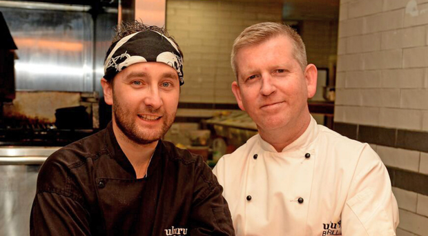 Dean Coppard (right) and head chef Mark McGonigle, who has been working with the Uluru brand for 12 years