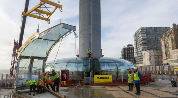 Workmen fitting the glass viewing pod to Brighton's British Airways i360