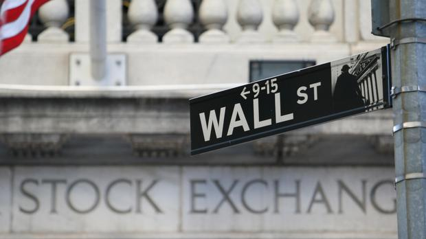 The Dow Jones industrial average slipped 2.95 points to 18,352.05