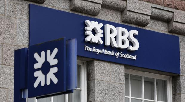 Ulster Bank owner Royal Bank of Scotland (RBS) has reported huge losses of more £2bn for the first half of the year