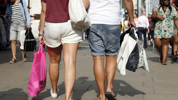 Households made the most of the warmer weather in July by spending more on new clothes, meals out and day trips, a report has found.