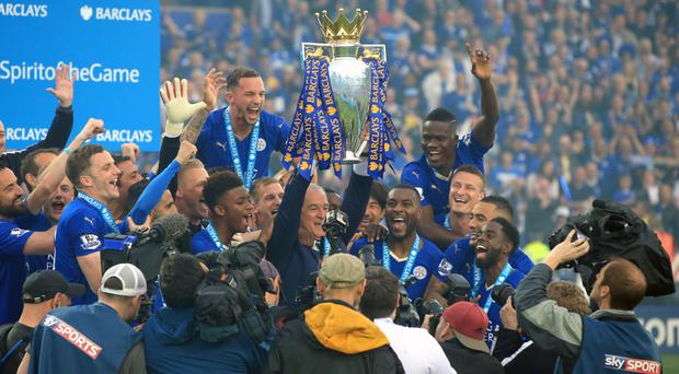 Leicester City captain Wes Morgan and manager Claudio Ranieri lift the trophy as the team celebrate winning the Barclays Premier League