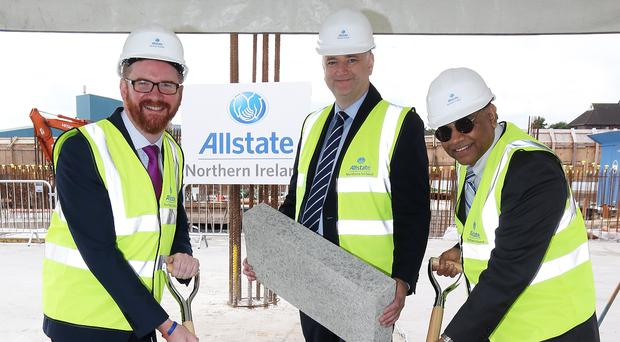 Economy Minister Simon Hamilton joins Allstate NI managing director John Healy and executive vice president Suren Gupta, to lay the foundation stone at the company's new headquarters