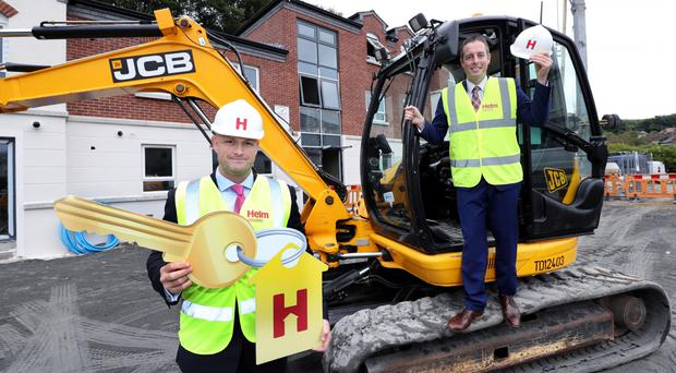 Housing Minister Paul Givan and Patrick McClughan, vice-chair of Helm Housing
