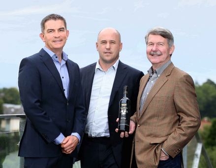 Gareth Bradley (left), managing director of Woodford Bourne NI, with Jake Cole of Treasury Wine Estates and Chris Hatcher, chief winemaker at Wolf Blass