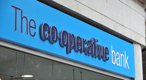 The Co-operative Bank said it would continue to post losses throughout this year