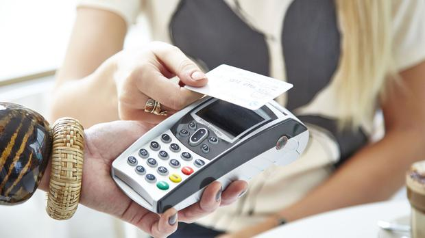 Britons ditching cheques and paying bills by contactless card, figures show