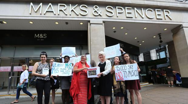 A group gathers outside Marks and Spencer's flagship store in Oxford Street, London, to hand in a petition