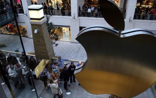 People queue in Belfast for the latest product at the Apple Store