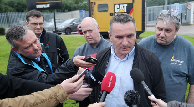 Davy Thompson from Unite union outside the Monkstown factory with a delegation of Caterpillar workers