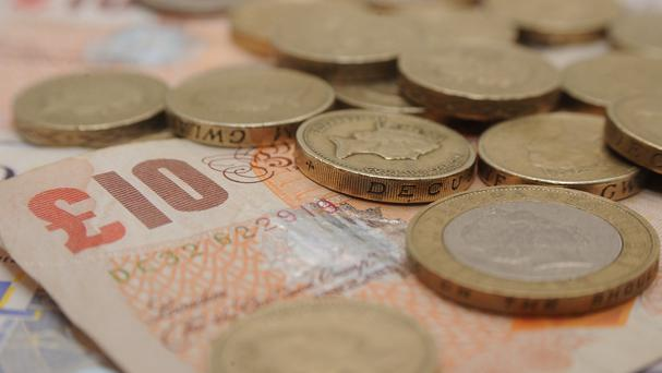 Teaching children about handling money could help them avoid financial problems in later life, Yorkshire Building Society said